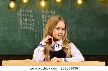 little genius at school. more idea of little genius. future little genius. little genius girl smiling at school. student on exam. poster