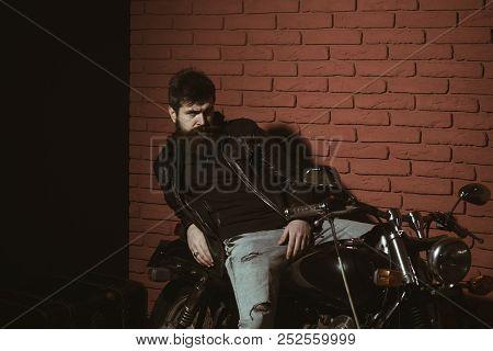 Bearded Man. Bearded Man In Leather Jacket. Bearded Man Relax On Motorcycle. Bearded Man Biker With