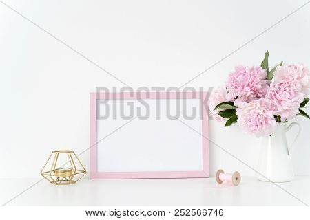 Pink Landscape Frame Mock Up With A Pink Peonies, Candle And Silk Ribbons Beside The Frame, Overlay