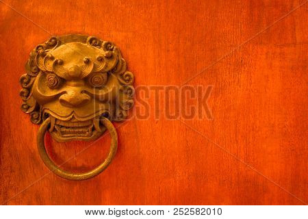 Metal Evil Face Pull Door And Hard Wood Surface Background