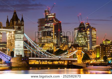 London Tower Bridge with London downtown skylines building in background, London UK.