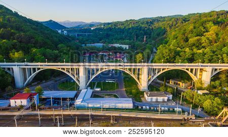 Drone View Of The Matsesta Viaduct And Railroad On The Background Of Mountainsides With Dense Forest