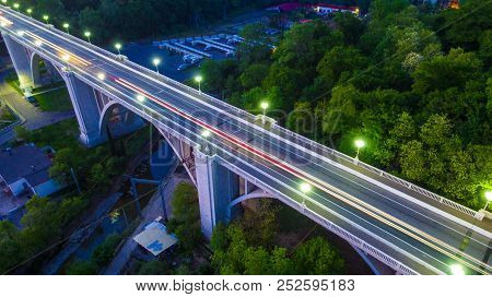 Drone View Of The Illuminated Matsesta Viaduct And Mountainside With Dense Forest At Twilight, Sochi