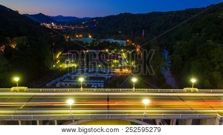 Drone View Of The Illuminated Matsesta Viaduct On The Background Of Mountainsides With Dense Forest