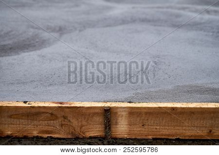 Wood Concrete Stopper And Fresh Concrete At The Background At Concrete Yard Construction