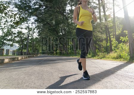 ํyoung Fitness Sports Woman Runner Running On Tropical Park Trail, Young Fitness Woman Running At Mo