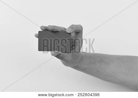 Advertising And Introducing Concept. Male Hand Holds Dark Green Card. Piece Of Paper
