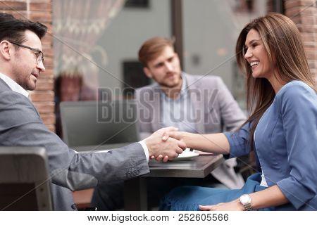 business woman at an informal meeting.