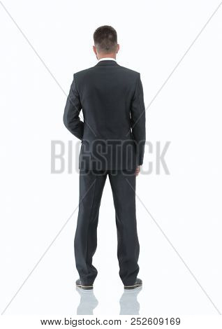 in full growth.rear view of confident businessman