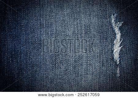 Denim Jeans Texture Or Denim Jeans Background With Old Torn. Old Grunge Vintage Denim Jeans.