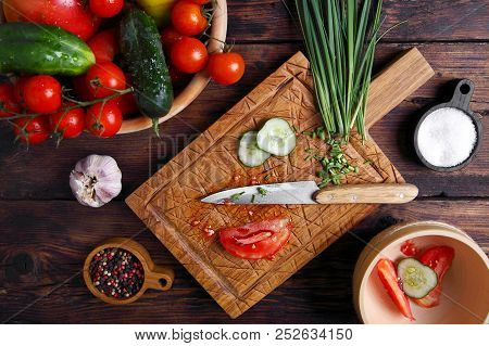 Ingredients For Salad With Fresh Vegetables On A Cutting Board