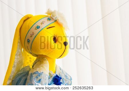Handmade Yellow Doll Bunny Close-up In Blue Dress