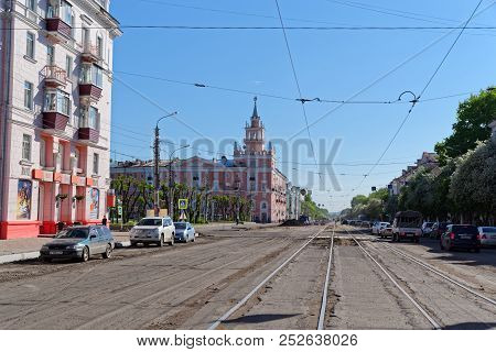 Komsomolsk-on-amur, Russia - May 26, 2018: View On The Pink House With A Spire (unofficial City Symb