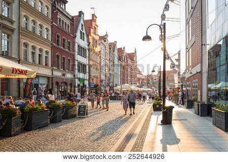 Gdansk, Poland - August 4, 2018: People on the street of the old town of Gdansk, Poland. Gdansk is the historical capital of Polish Pomerania with medieval old town architecture.
