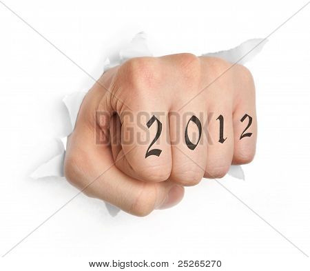 Hand with 2012 tattoo punching through paper isolated on white poster