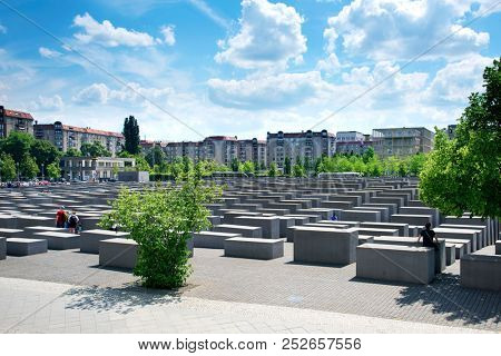 BERLIN, GERMANY - MAY 25, 2018: Visitors at the Memorial to the Murdered Jews of Europe, also known as Holocaust Memorial, in Berlin, Germany