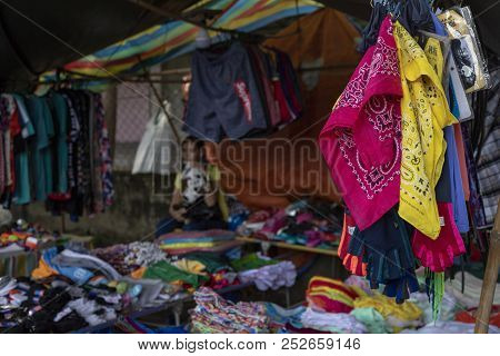 Dumaguete, The Philippines - 27 July 2018: Cheap Colorful Clothes On Local Market Store. Second Hand