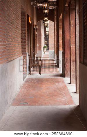 Walkway Along The Red Brick Wall, Stock Photo