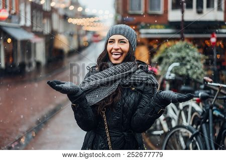 Girl In The Street In The Rain
