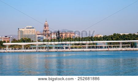 Malaga, Spain - August 03, 2018. View Of Paseo Del Muelle Uno In Port Of Malaga. Muelle Uno, Cathedr