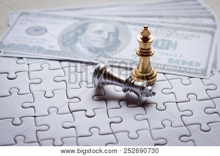 Golden King Chess Piece Win The Silver King Chess On The Game With Puzzle And Banknotes Background F