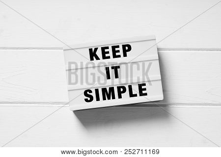 Keep It Simple Text On Lightbox Sign, Minimal Flat Lay Design On White Wooden Background, Simplicity