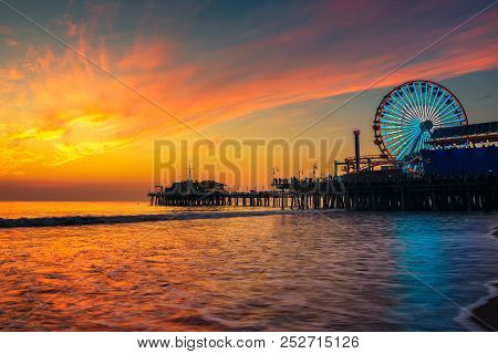 Visitors Enjoy Scenic Sunset Above Santa Monica Pier In Los Angeles, California.