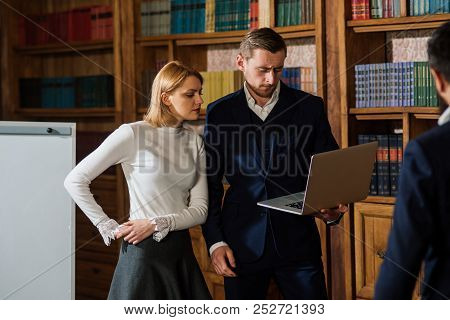 Startup Concept. Group Of Students Working For Successful Startup In Library. Men And Woman Discuss
