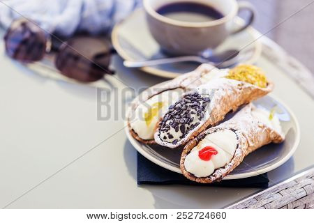 A scrumptious plate of Sicilian Cannoli with chocolate chips. A yummy treat dessert poster