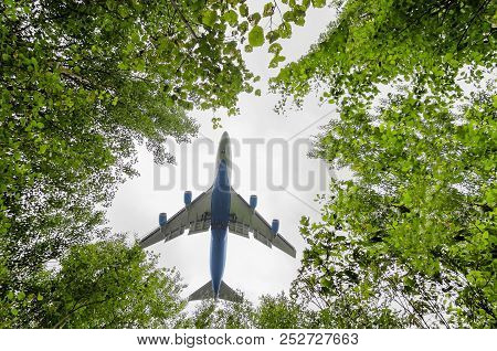 Big Blue Passenger Aircraft Delivers Passengers And Cargo, Lands In The Airport, Wide View Of Owerfl