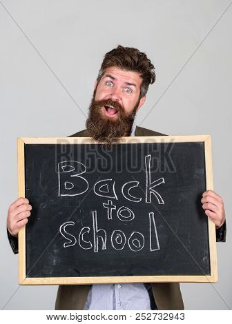 School Teacher Wait For You. Teacher Or Bearded Educator Stands And Holds Blackboard With Inscriptio