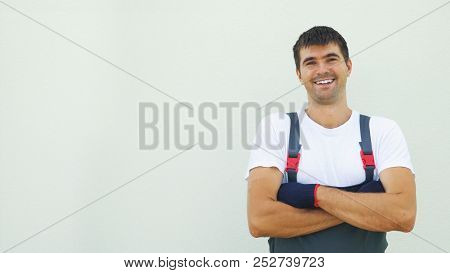 Portrait Happy Caucasian Male Industrial Worker In Work Clothes Crossing Hands Looking At Camera Iso