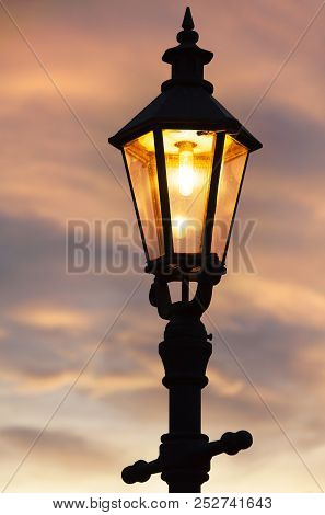 The Lighted Lamppost After The Sunset In Wieliczka Old Town (poland).