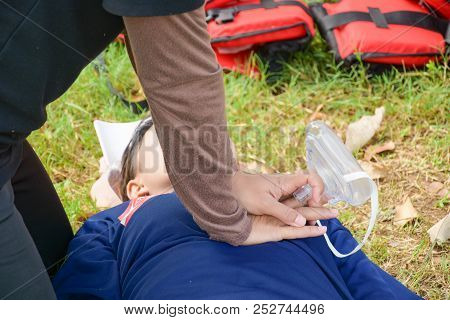 Woman Chest Compression In Cpr Training Course In Victim Drowning