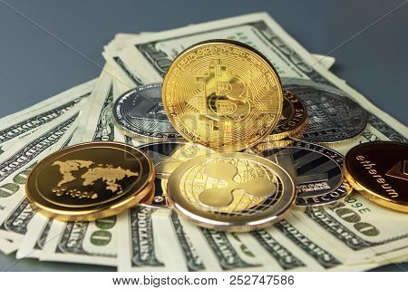 Coins Of Different Crypto-currencies With Dollars. Bitcoin, Dash, Ripple, Ethereum Litecoin