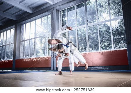Two Judo Fighters Showing Technical Skill While Practicing Martial Arts In A Fight Club. The Two Fit