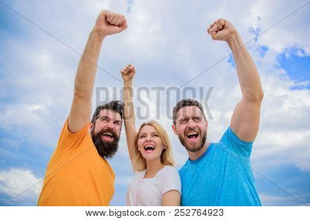 We Can Do It. Woman And Men Look Successful Celebrate Victory Sky Background. Threesome Stand Happy