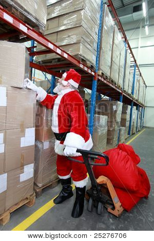 Santa claus looking for presents  in storehouse