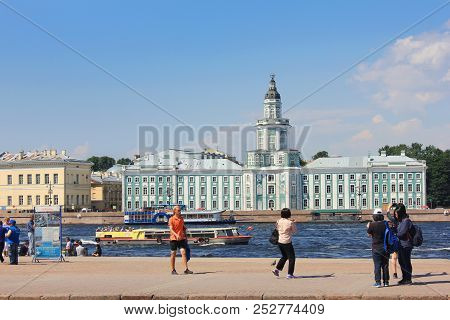 St. Petersburg, Russia - July 15, 2018: Tourists At City Center With Kunstkamera Museum And Tourist