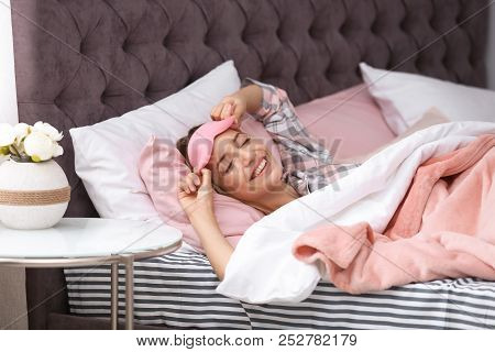 Young Beautiful Woman With Sleeping Mask Waking Up In Morning At Home