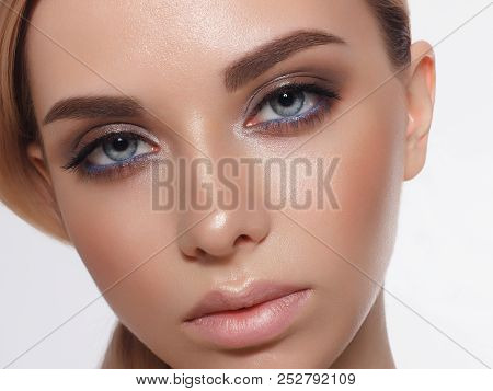 Close-up Portrait Of Sexy Young Woman With Beautiful Blue Eyes. Woman Beauty Face Portrait With Heal