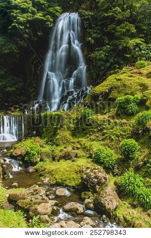 Waterfalls In Azores Always Provide A Very High Contrast Against The Lush Green Of The Island. They