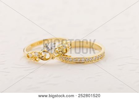 Set Of Gold Tiara Ring With Heart Shape Diamond And Band Ring On White Background