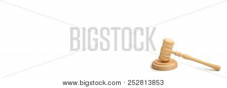 Wooden Judge Hammer On A White Background. Court Cases. Lawyers And Prosecutors. Assistance And Prot