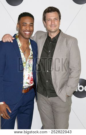 LOS ANGELES - AUG 7:  Titus Makin Jr, Nathan Fillion at the ABC TCA Party- Summer 2018 at the Beverly Hilton Hotel on August 7, 2018 in Beverly Hills, CA
