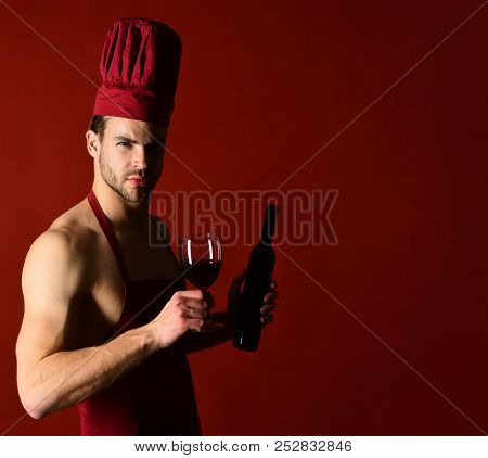 Restaurant. Wine Cellar. Red Wine. Chef In Apron Tastes Wine. Bearded Man Holds Bottle Of Wine. Wine