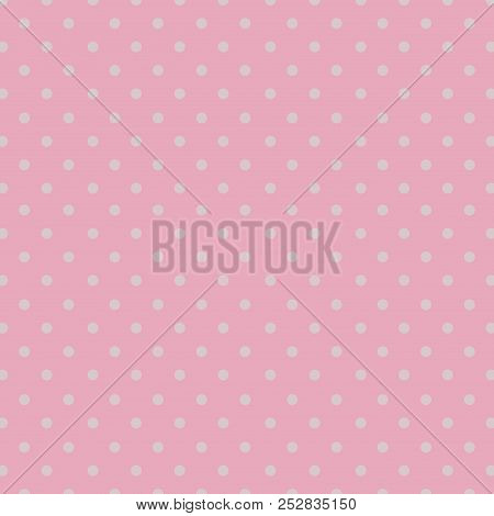 Seamless Repeating Polka Dot Spotty Pattern With Small White Spots On A Pale Pastel Pink Background.