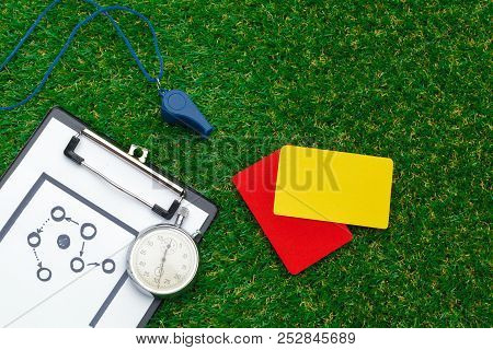 two penalty cards and a whistle for the referee poster
