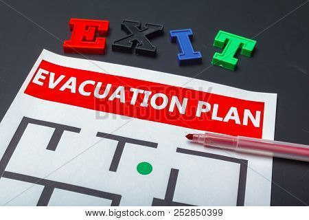 Emergency Evacuation Plan. Macro Photography. Close Up. Object.