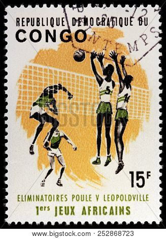 Luga, Russia - January 23, 2018:  A Stamp Printed By Congo Shows Volleyball Players, Circa 1965